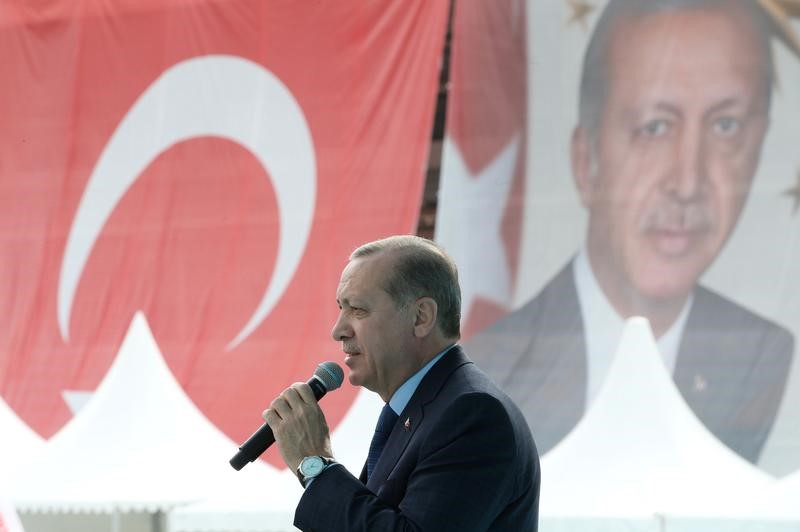 FILE PHOTO: Turkish President Tayyip Erdogan delivers a speech during a ceremony in Bursa, Turkey April 5, 2017. Yasin Bulbul/Presidential Palace/Handout via REUTERS