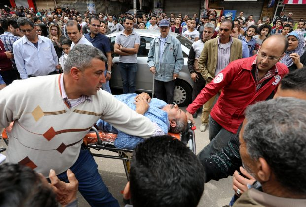 A victim is seen on a stretcher after a bomb went off at a Coptic church in Tanta, Egypt, April 9, 2017. REUTERS/Mohame
