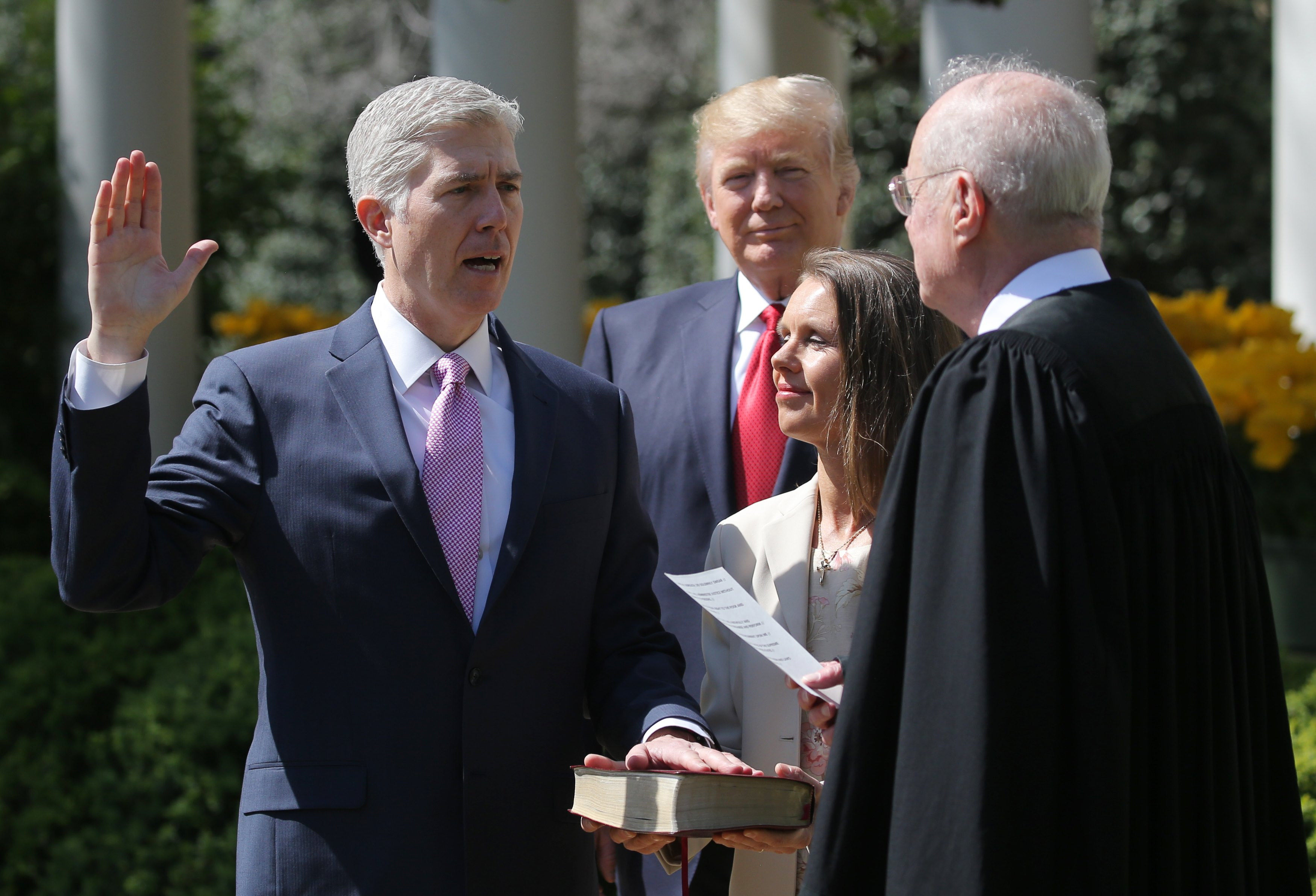 udge Neil Gorsuch (L) is sworn in as an associate justice of the Supreme Court by Supreme Court Associate Justice Anthony Kennedy (R) , as U.S. President Donald J. Trump (C) watches with Louise Gorsuch in the Rose Garden of the White House in Washington, U.S