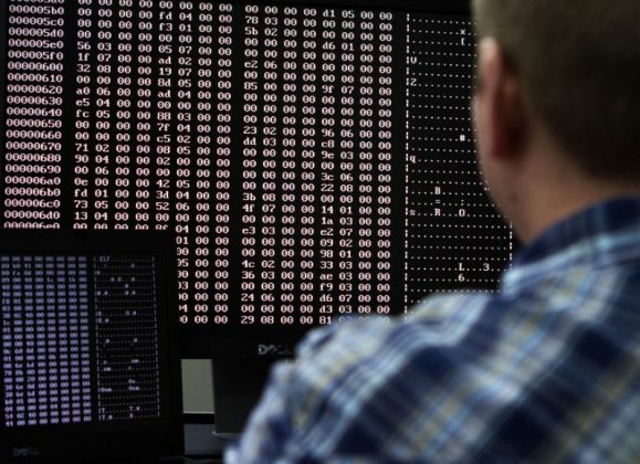 An analyst looks at code in the malware lab of a cyber security defense lab at the Idaho National Laboratory in Idaho Falls, Idaho