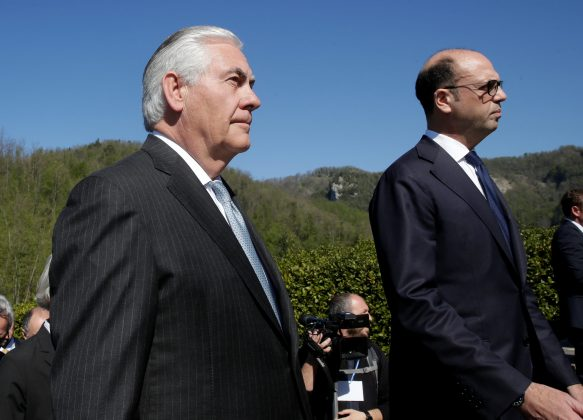 U.S. Secretary of State Rex Tillerson (L) and Italy's Foreign Minister Angelino Alfano arrive to attend a ceremony at the Sant'Anna di Stazzema memorial, dedicated to the victims of the massacre committed in the village of Sant'Anna di Stazzema by Nazis in 1944 during World War II, Italy