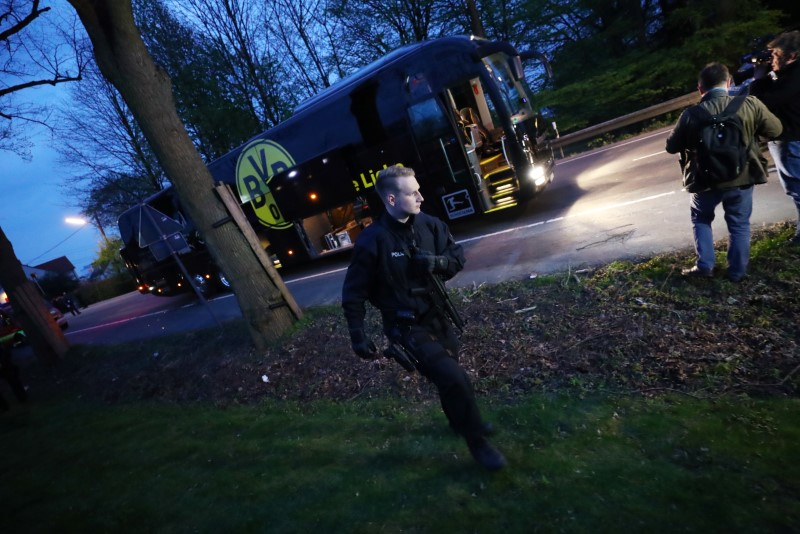 Football Soccer - Borussia Dortmund v AS Monaco - UEFA Champions League Quarter Final First Leg - Signal Iduna Park, Dortmund, Germany - 11/4/17 Police with the Borussia Dortmund team bus after an explosion near their hotel before the game