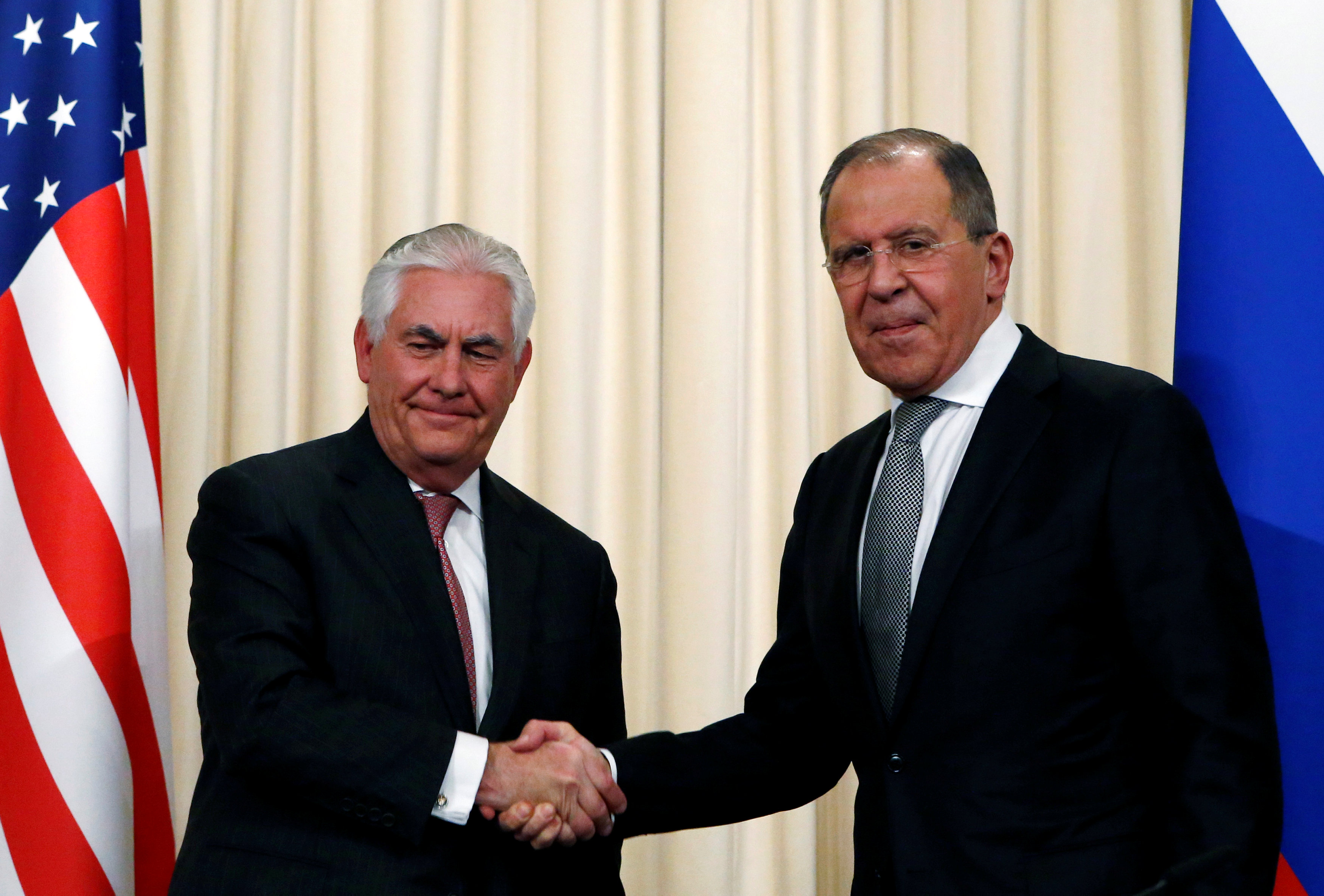 Russian Foreign Minister Sergei Lavrov shakes hands with U.S. Secretary of State Rex Tillerson during a news conference following their talks in Moscow, Russia,