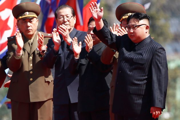 North Korean leader Kim Jong Un waves to people cheering during an opening ceremony of a newly constructed residential complex in Ryomyong street in Pyongyang, North Korea April 13, 2017. REUTERS/Damir Sagolj