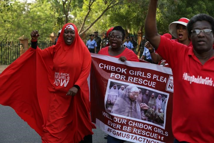 Campaigners from the #BringBackOurGirls group protest in Nigeria's capital Abuja to mark 1,000 days since over 200 schoolgirls were kidnapped from their secondary school in Chibok by Islamist sect Boko Haram, Nigeria January 8, 2017. REUTERS/Afolabi Sotunde