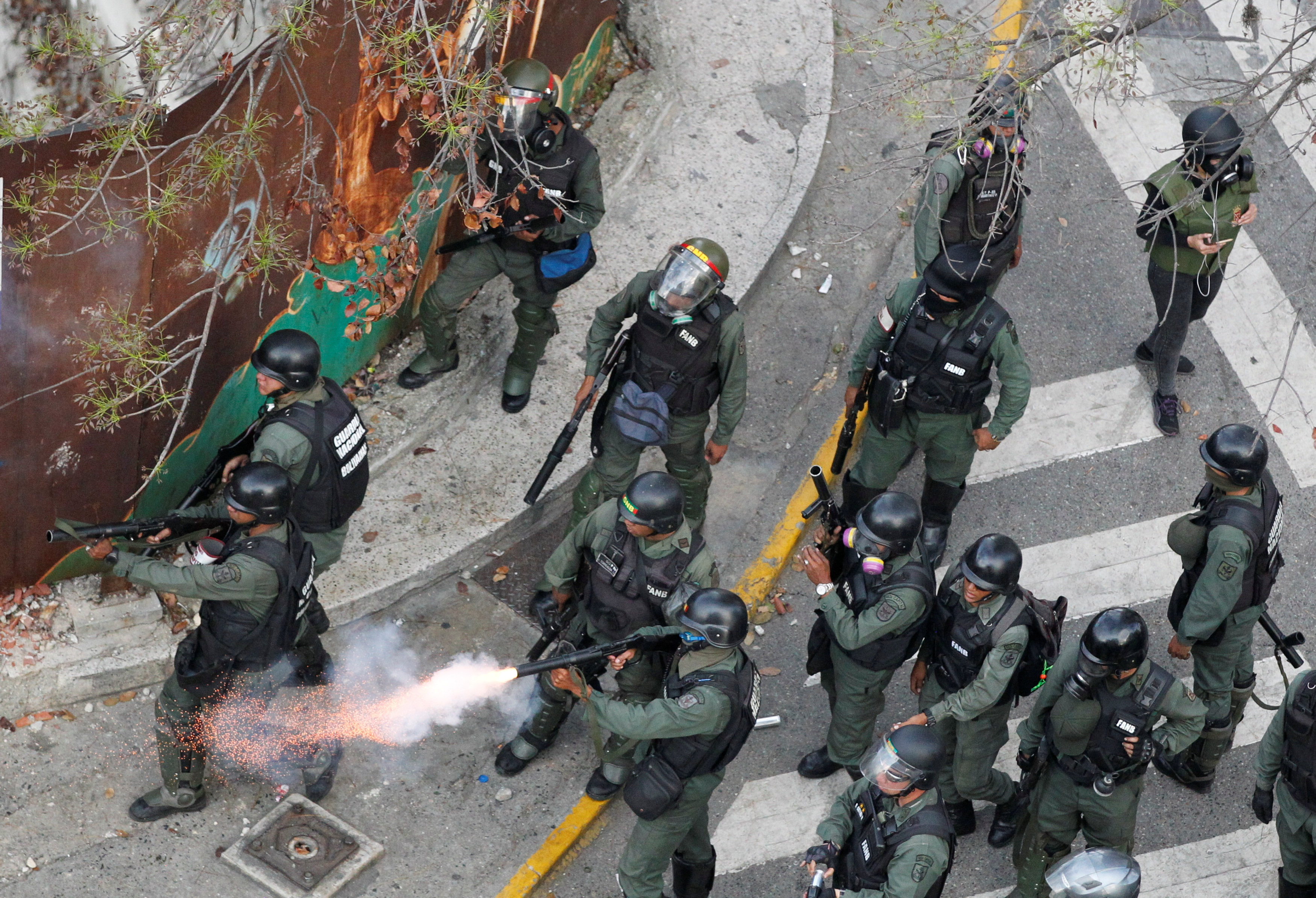 Riot police fire tear gas during a rally against Venezuela's President Nicolas Maduro's government in Caracas, Venezuela April 10, 2017. REUTERS/Christian Veron