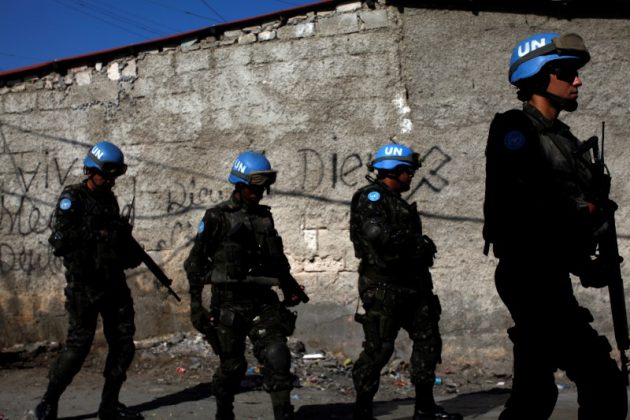 U.N. peacekeepers walk along a street during a patrol with Haitian national police officers and members of UNPOL (United Nations Police) in the neighborhood of Cite Soleil, in Port-au-Prince, Haiti, March 3, 2017. Picture taken March 3, 2017. REUTERS/Andres Martinez Casares