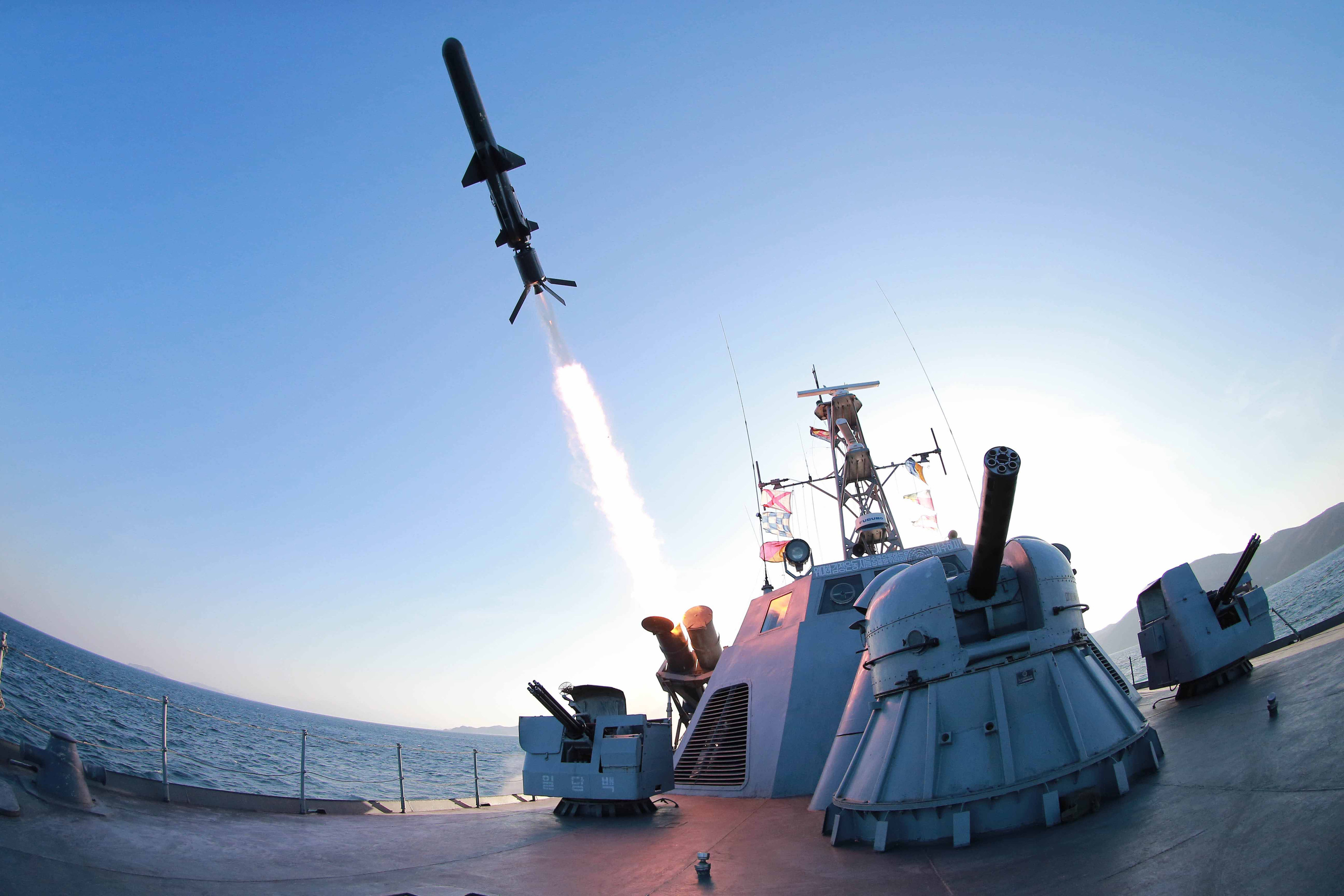 A missile is fired from a naval vessel during the test-firing of a new type of anti-ship cruise missile to be equipped at Korean People's Army naval units. REUTERS/KCNA