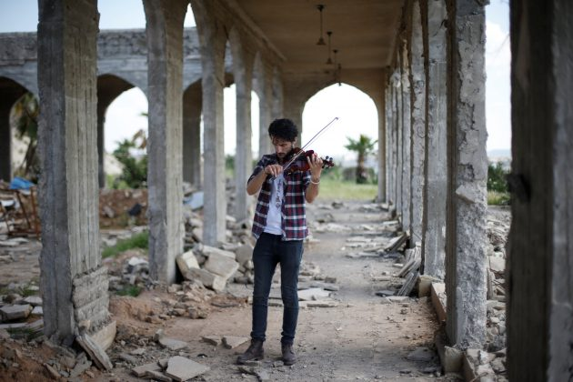 Ameen Mukdad, a violinist from Mosul who lived under ISIS's rule for two and a half years where they destroyed his musical instruments, performs in eastern Mosul, Iraq, April 19, 2017. REUTERS/ Muhammad Hamed
