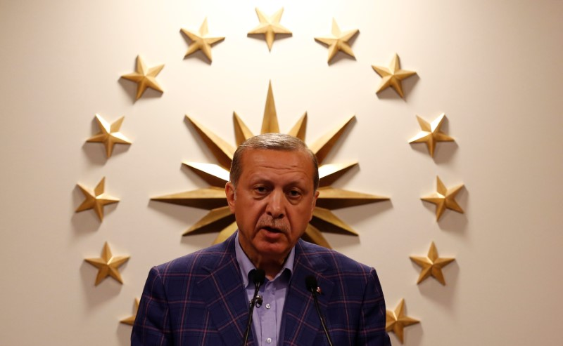 FILE PHOTO: Turkish President Tayyip Erdogan speaks during a news conference in Istanbul, Turkey, late April 16, 2017. REUTERS/Murad Sezer/File Photo