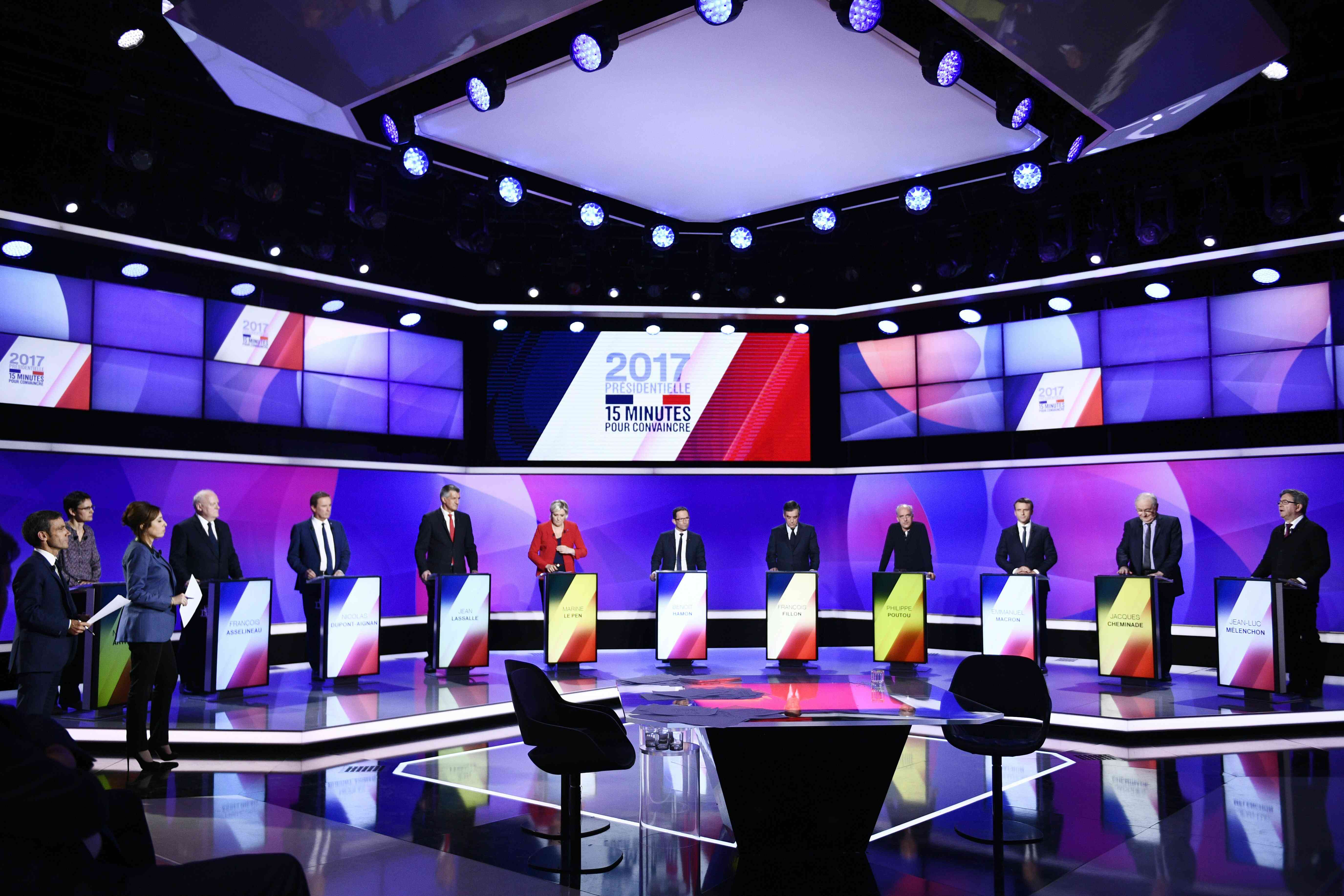 "The eleven French presidential election candidates take part in a special political television show entitled ""15min to Convince"" at the studios of French Television channel France 2 in Saint-Cloud, near Paris, April 20, 2017. REUTERS/Martin Bureau/Pool"