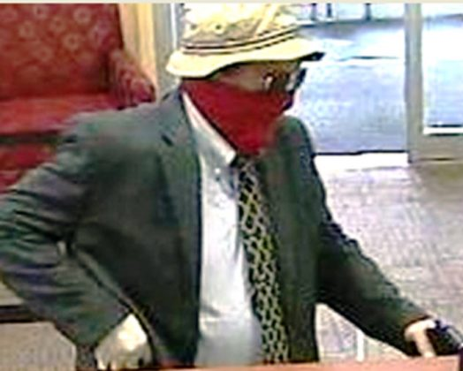 "A man the FBI identified as Richard Boyle, of Doylestown, Pennsylvania, known as the ""Straw Hat Bandit,"" is pictured in this undated handout still image from video. FBI/Handout via REUTERS"
