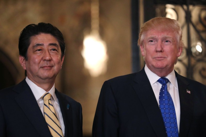 Japanese Prime Minister Shinzo Abe and U.S. President Donald Trump pose for a photograph before attending dinner at Mar-a-Lago Club in Palm Beach, Florida,