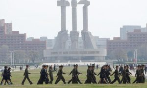 Soldiers walk in front of the Monument to the Foundation of the Workers' Party in Pyongyang, North Korea April 16, 2017. REUTERS/Damir Sagolj