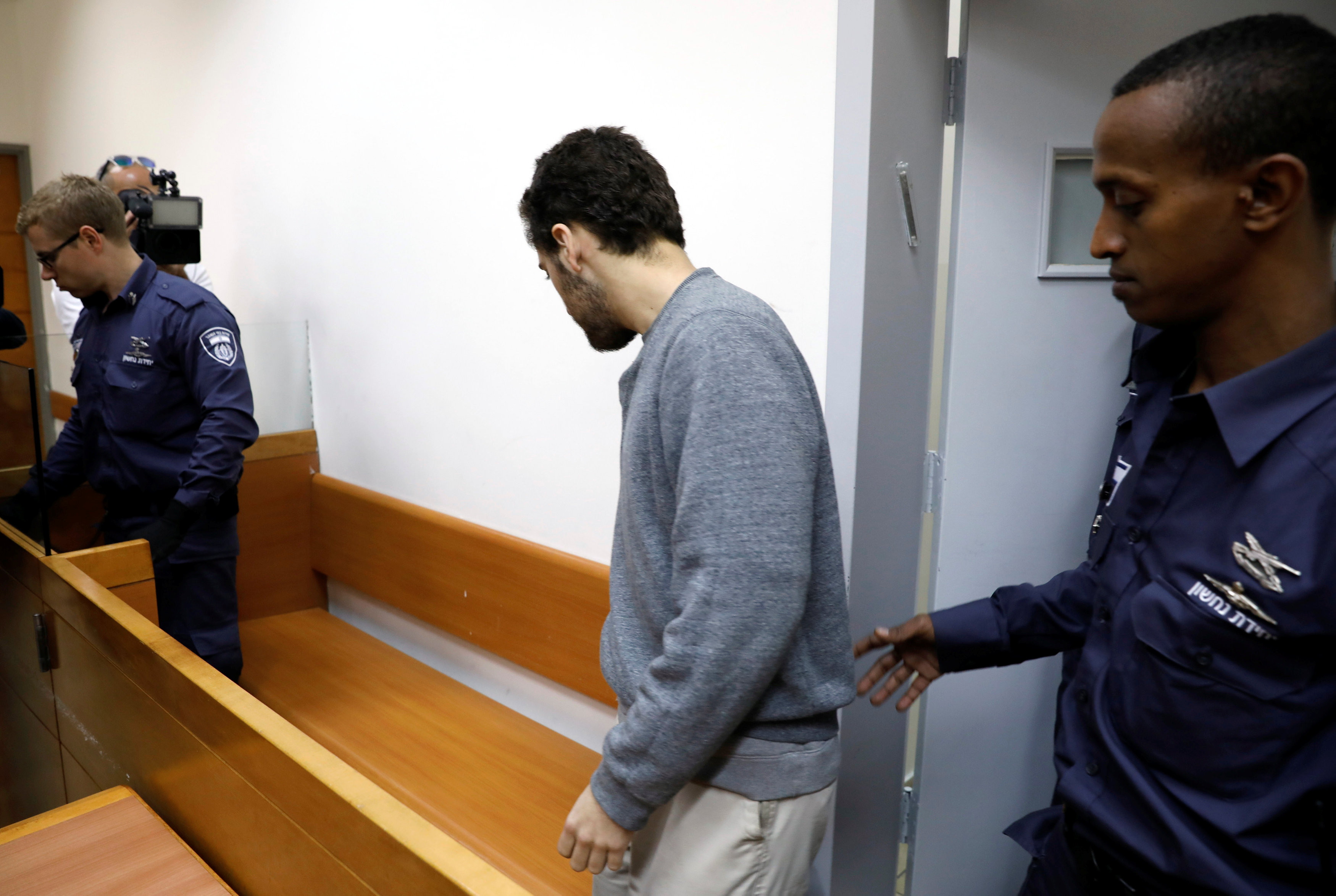 An U.S.-Israeli teen, who was arrested in Israel on suspicion of making bomb threats against Jewish community centres in the United States, Australia and New Zealand, arrives before the start of a remand hearing at Magistrate's Court in Rishon Lezion, Israel April 20, 2017. REUTERS/ Amir Cohen