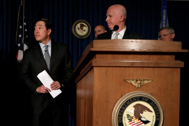 Joon H. Kim (L), the Acting United States Attorney for the Southern District of New York, and New York City Police Commissioner James O'Neill (C) attend a news conference to announce the arrest of three retired New York City Police (NYPD) officers in connection with a Federal corruption investigation into the NYPD's gun license Division in New York City, U.S., April 25, 2017. REUTERS/Mike Segar