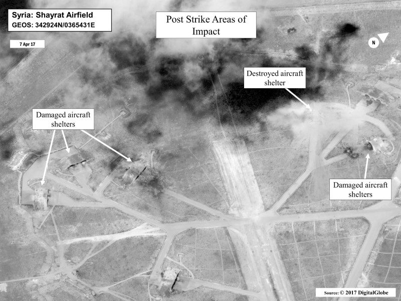 FILE PHOTO: Battle damage assessment image of Shayrat Airfield, Syria, is seen in this DigitalGlobe satellite image, released by the Pentagon following U.S. Tomahawk Land Attack Missile strikes from Arleigh Burke-class guided-missile destroyers, the USS Ross and USS Porter on April 7, 2017. DigitalGlobe/Courtesy U.S. Department of Defense/Handout via REUTERS