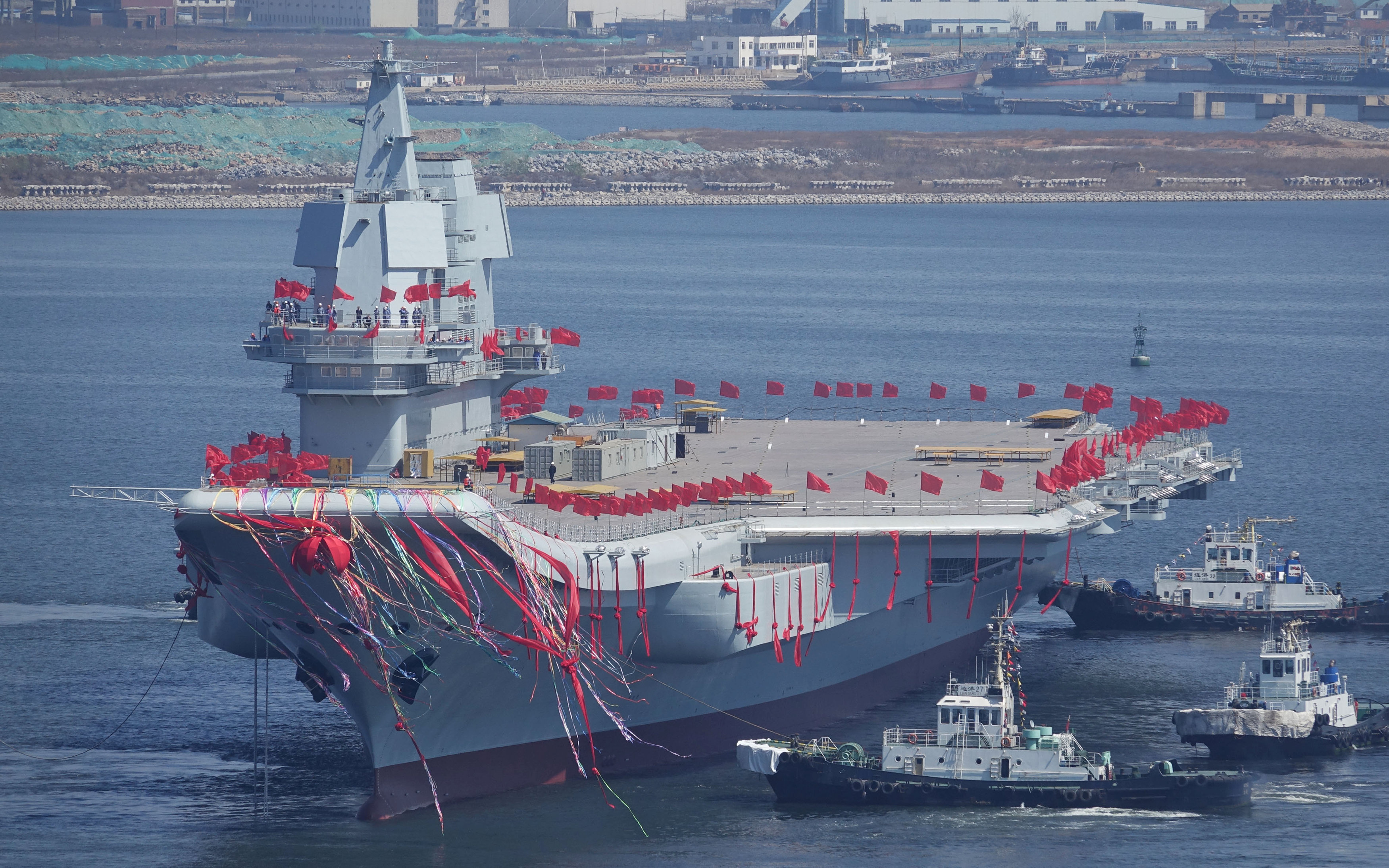 China's first domestically built aircraft carrier is seen during its launching ceremony in Dalian, Liaoning province, China, April 26, 2017. REUTERS/Stringer