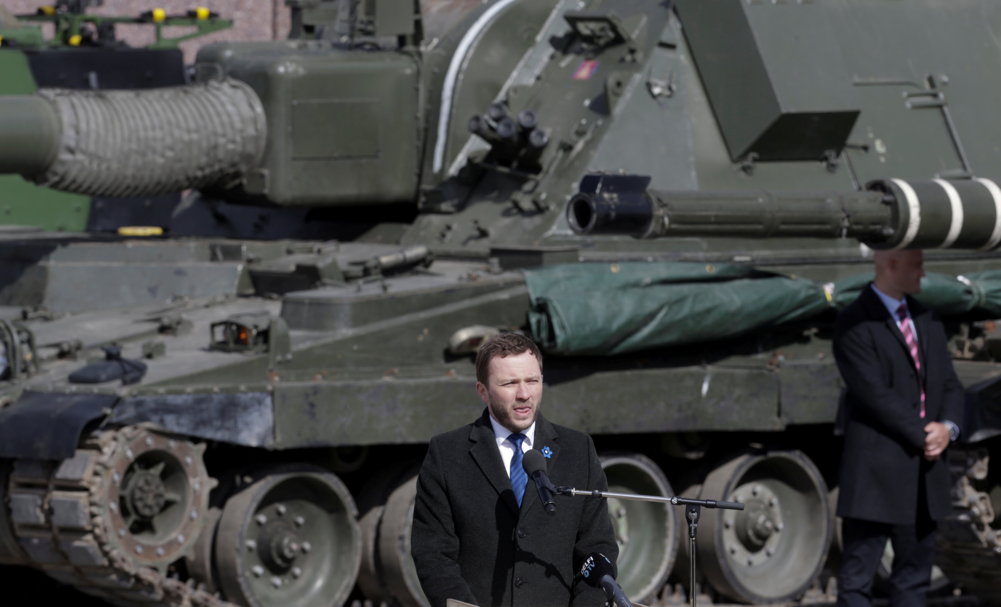 FILE PHOTO: Estonia's Defence Minister Margus Tsahkna speaks during the official ceremony welcoming the deployment of a multi-national NATO battalion in Tapa, Estonia, April 20, 2017. REUTERS/Ints Kalnins/File Photo