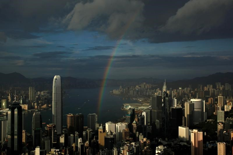 FILE PHOTO: A rainbow arches over Hong Kong's Victoria Harbour June 19, 2012. REUTERS/Bobby Yip/File Photo