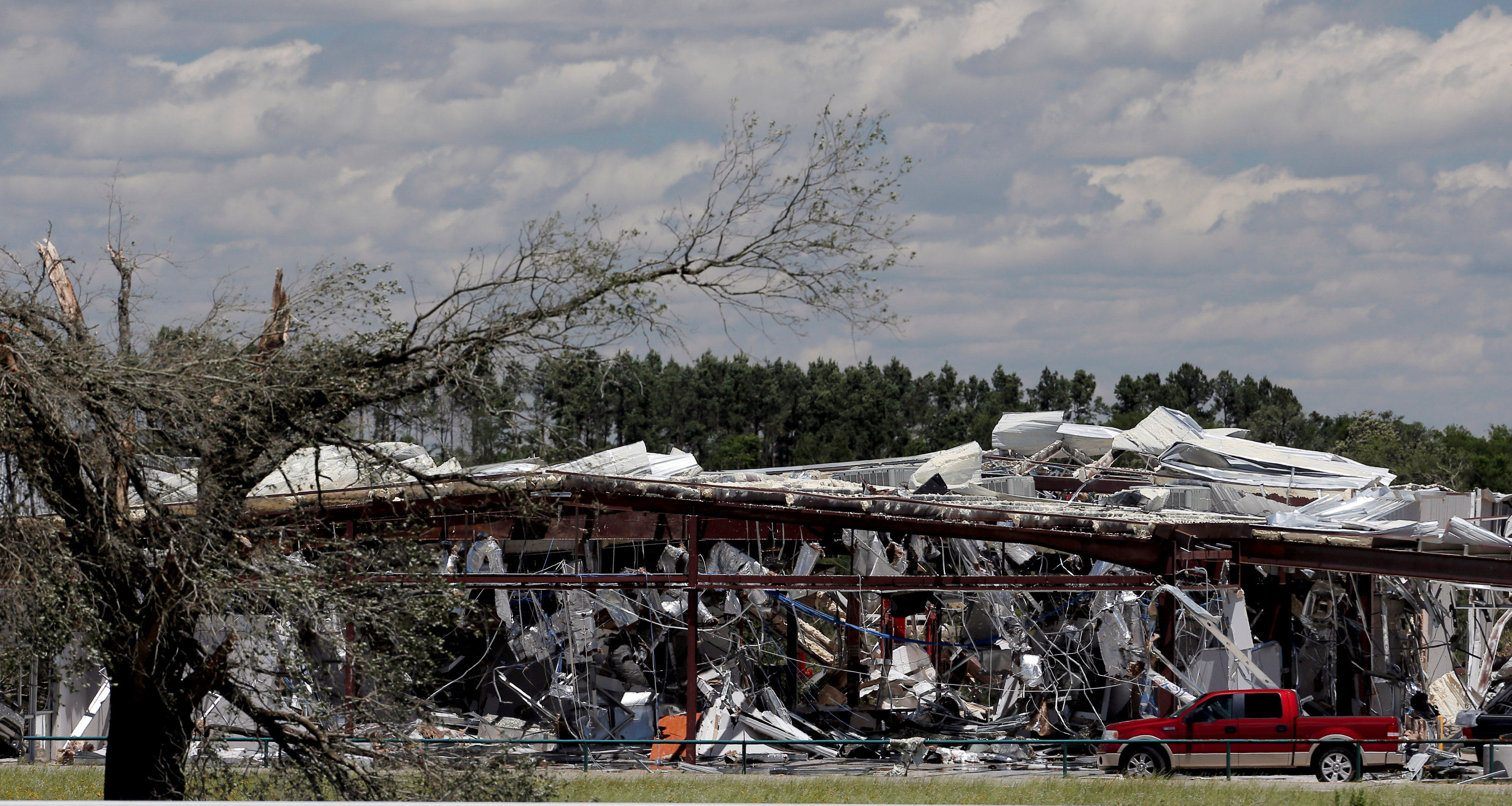 A business damaged by tornadoes is seen in Canton, Texas