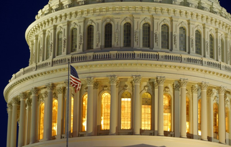 The U.S. Capitol Dome is seen before dawn in Washington.