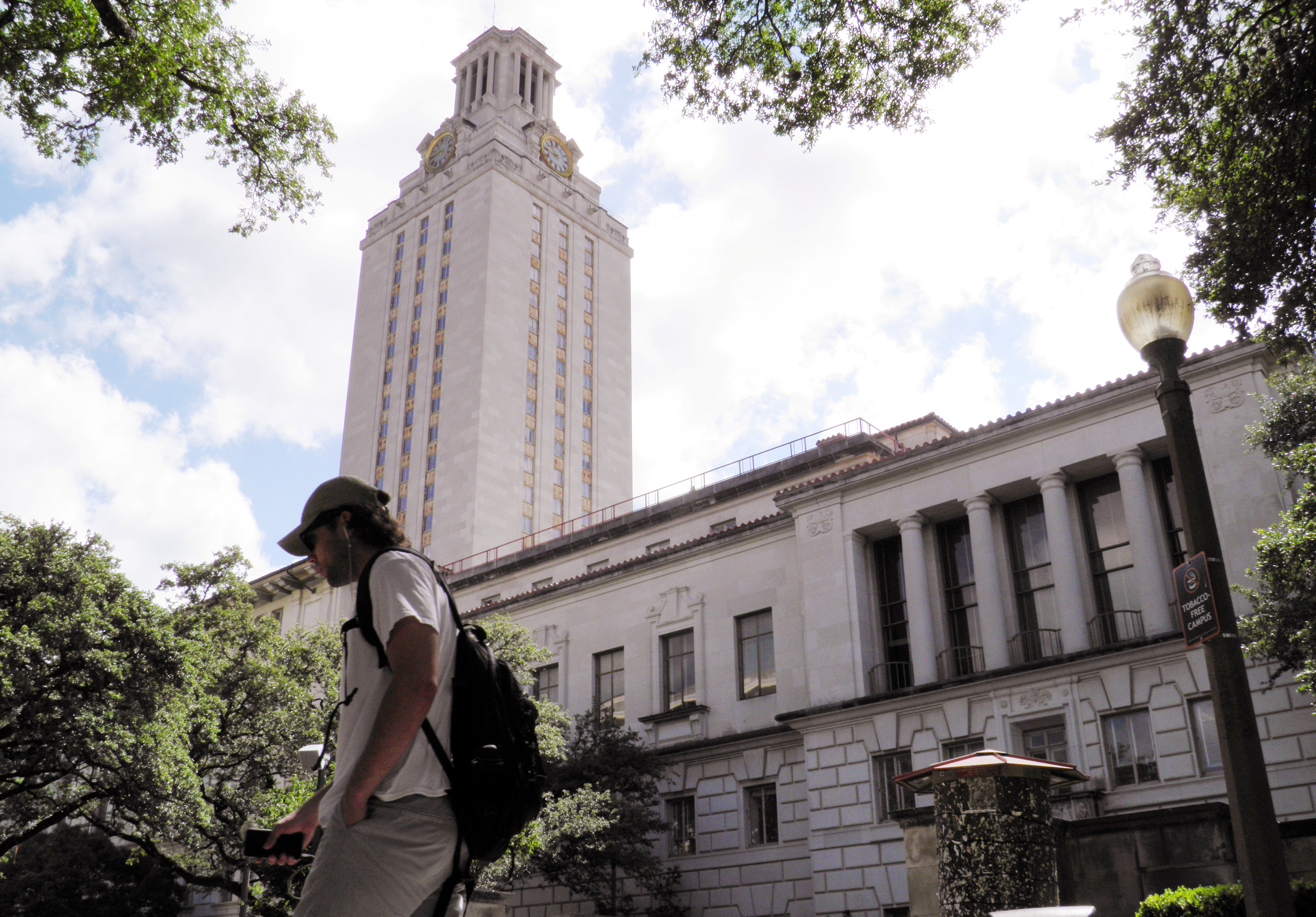 FILE PHOTO: A student walks at the University of Texas campus in Austin, Texas, U.S., on June 23, 2016. REUTERS/Jon Herskovitz/File Photo