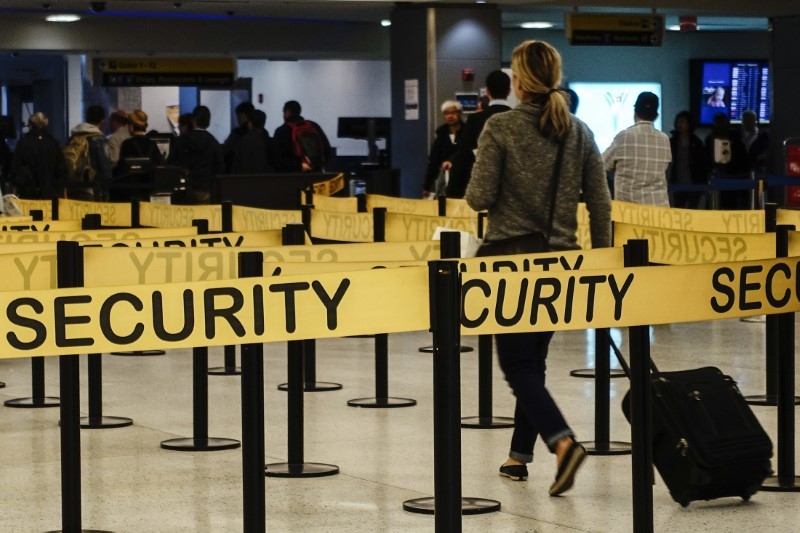 FILE PHOTO - Passengers make their way in a security checkpoint at the International JFK airport in New York October 11, 2014. REUTERS/Eduardo Munoz