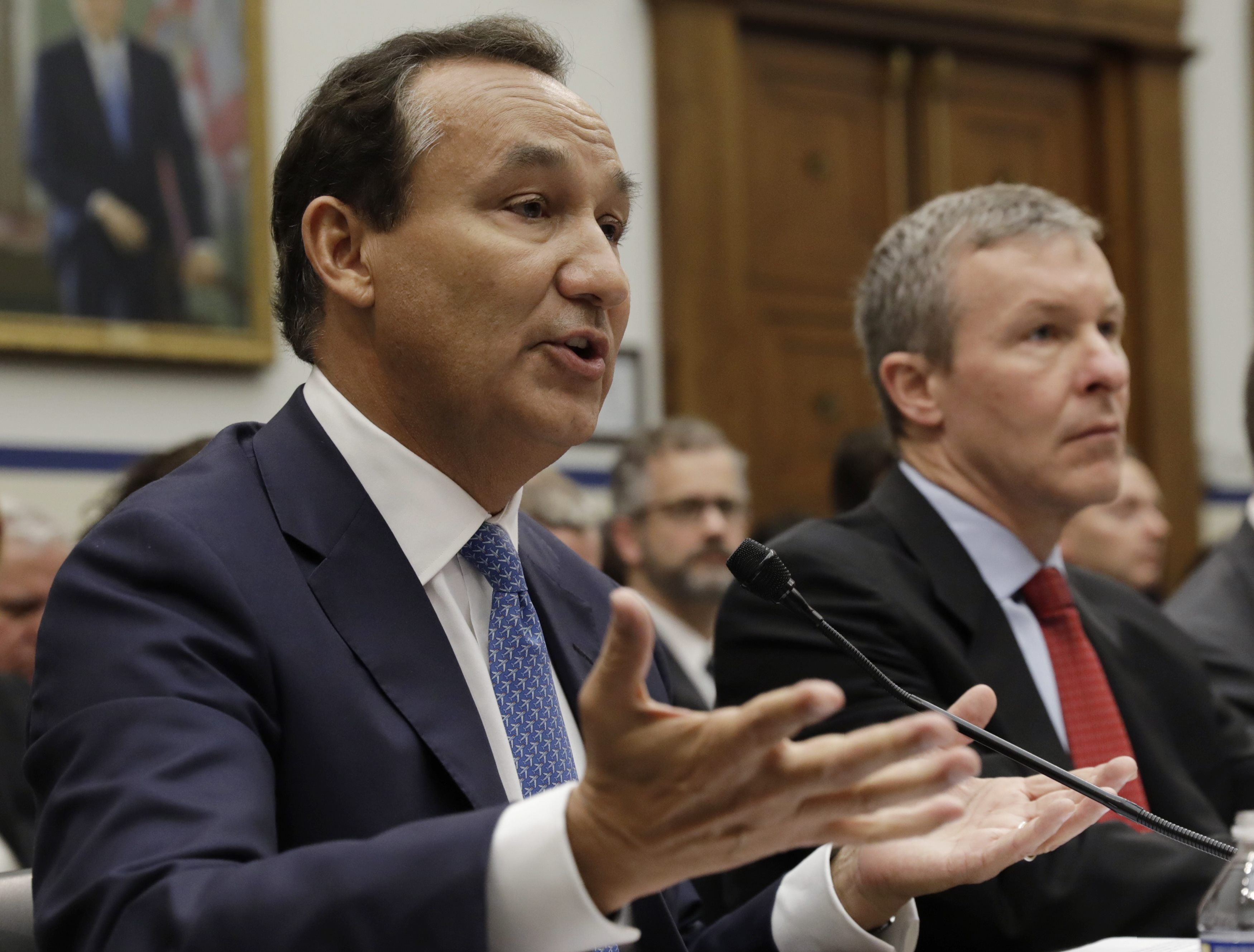 "United Airlines CEO Oscar Munoz (L) testifies next to UAL President Scott Kirby at a House Transportation and Infrastructure Committee hearing on ""Oversight of U.S. Airline Customer Service,"" in the aftermath of the forced removal on April 9 of a passenger from a UAL Chicago flight, on Capitol Hill in Washington, U.S., May 2, 2017. REUTERS/Kevin Lamarque"