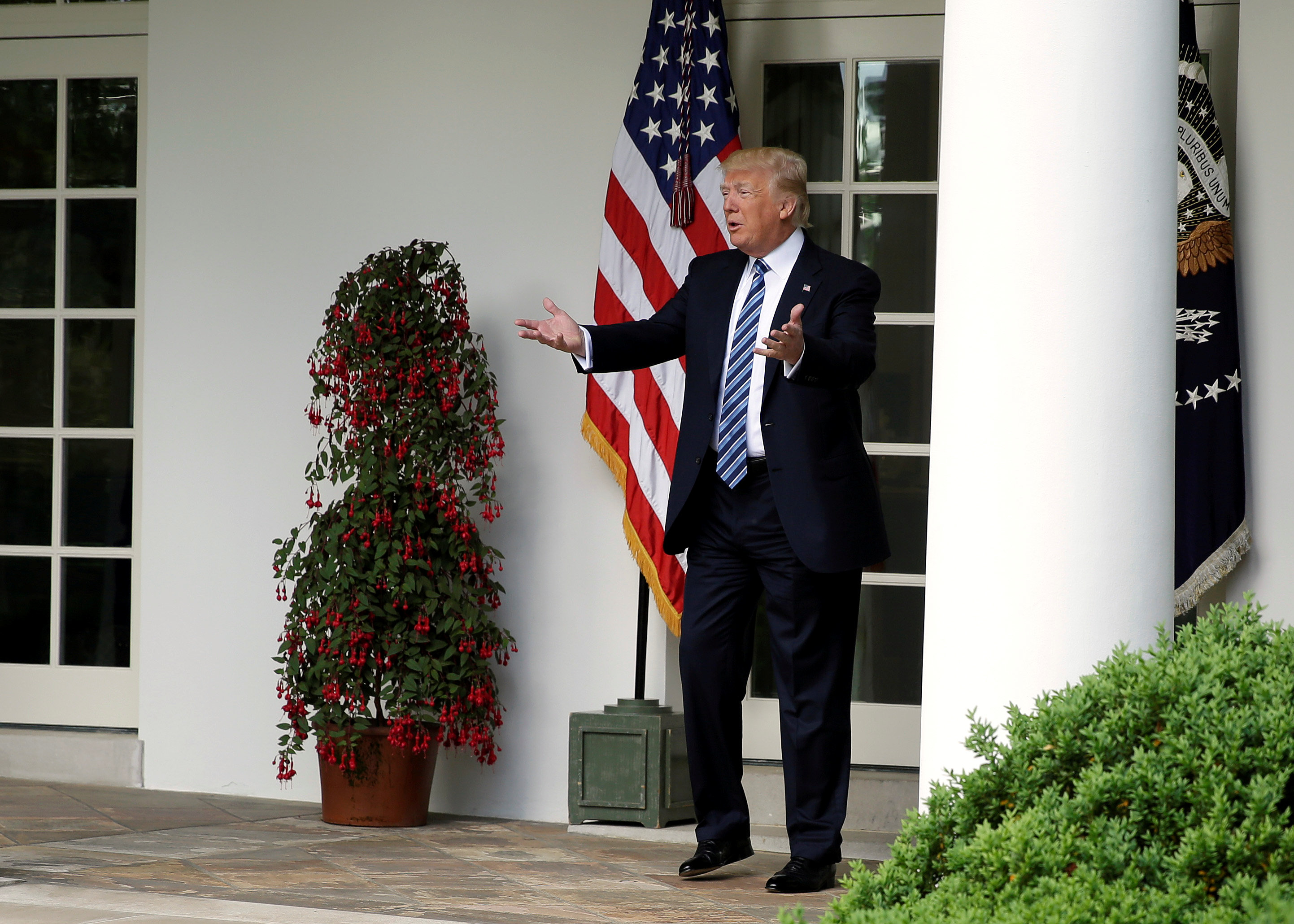 U.S. President Donald Trump speaks to staffers setting up for the Commander in Chief's trophy presentation in the Rose Garden of the White House in Washington, U.S., May 2, 2017. REUTERS/Joshua Roberts