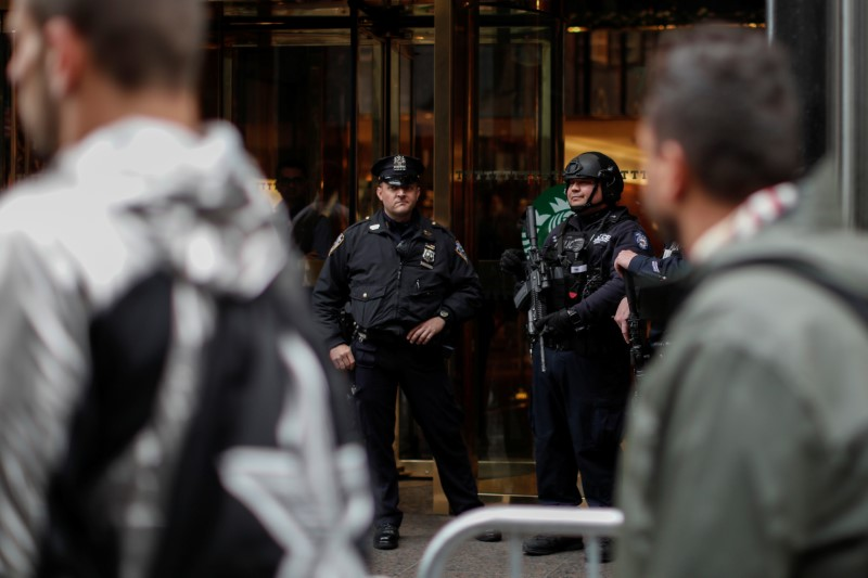 New York City Police Department (NYPD) officers stand guard outside the entrance of Trump Tower in New York City, U.S., April 26, 2017. REUTERS/Mike Segar