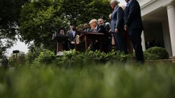 U.S. President Donald Trump signs an Executive Order on Promoting Free Speech and Religious Liberty during the National Day of Prayer event at the Rose Garden of the White House in Washington D.C., U.S., May 4, 2017.