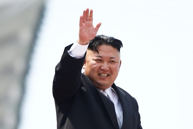 North Korean leader Kim Jong Un waves to people attending a military parade marking the 105th birth anniversary of country's founding father, Kim Il Sung in Pyongyang. REUTERS/Damir Sagolj