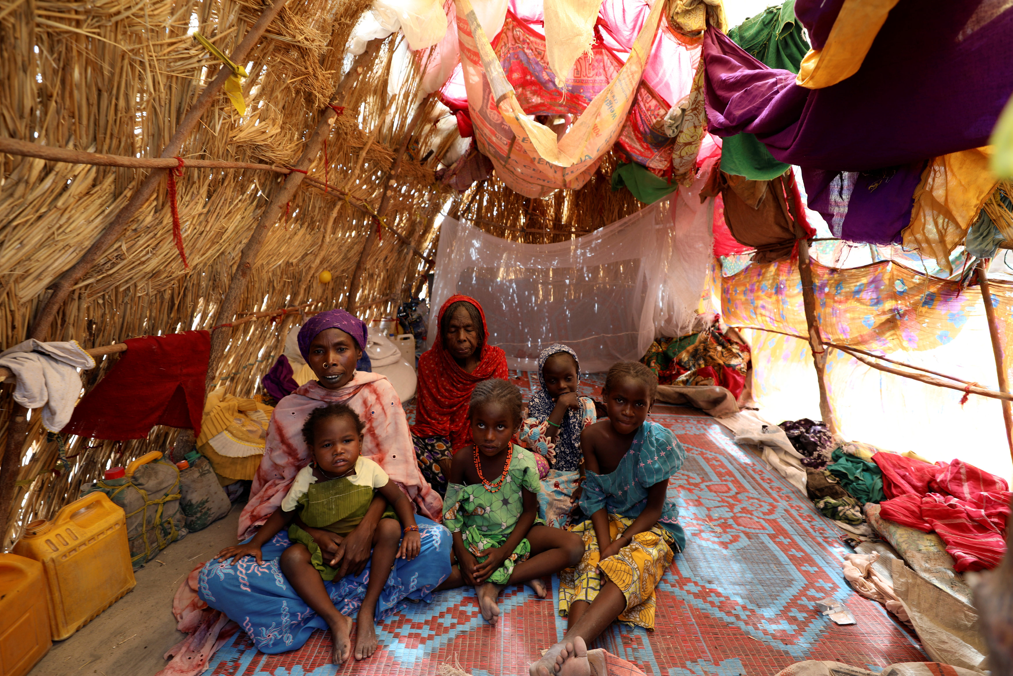 A family is pictured in their straw grass home at the IDP camp at Gamboru, Borno, Nigeria April 27, 2017. REUTERS/Afolabi Sotunde