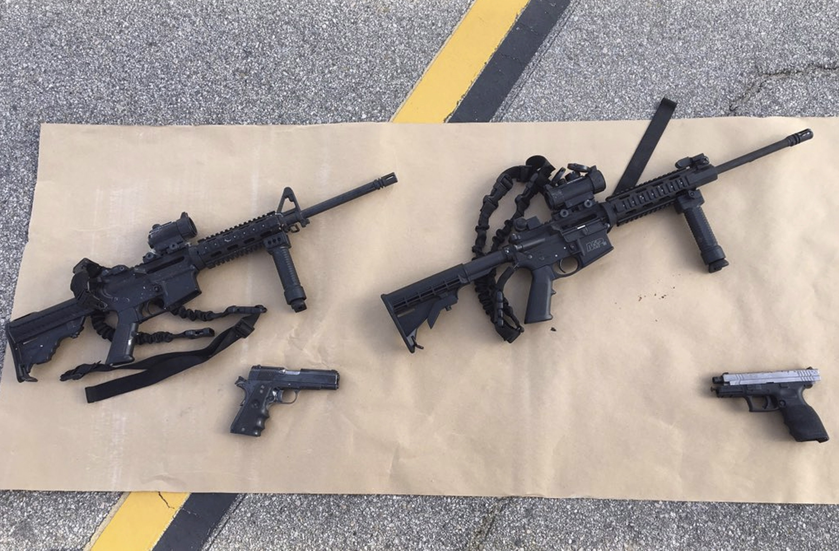 FILE PHOTO: Weapons confiscated from the attack in San Bernardino, California are shown in this San Bernardino County Sheriff Department handout photo from their Twitter account released to Reuters December 3, 2015. REUTERS/San Bernardino County Sheriffs Department/Handout/File Photo