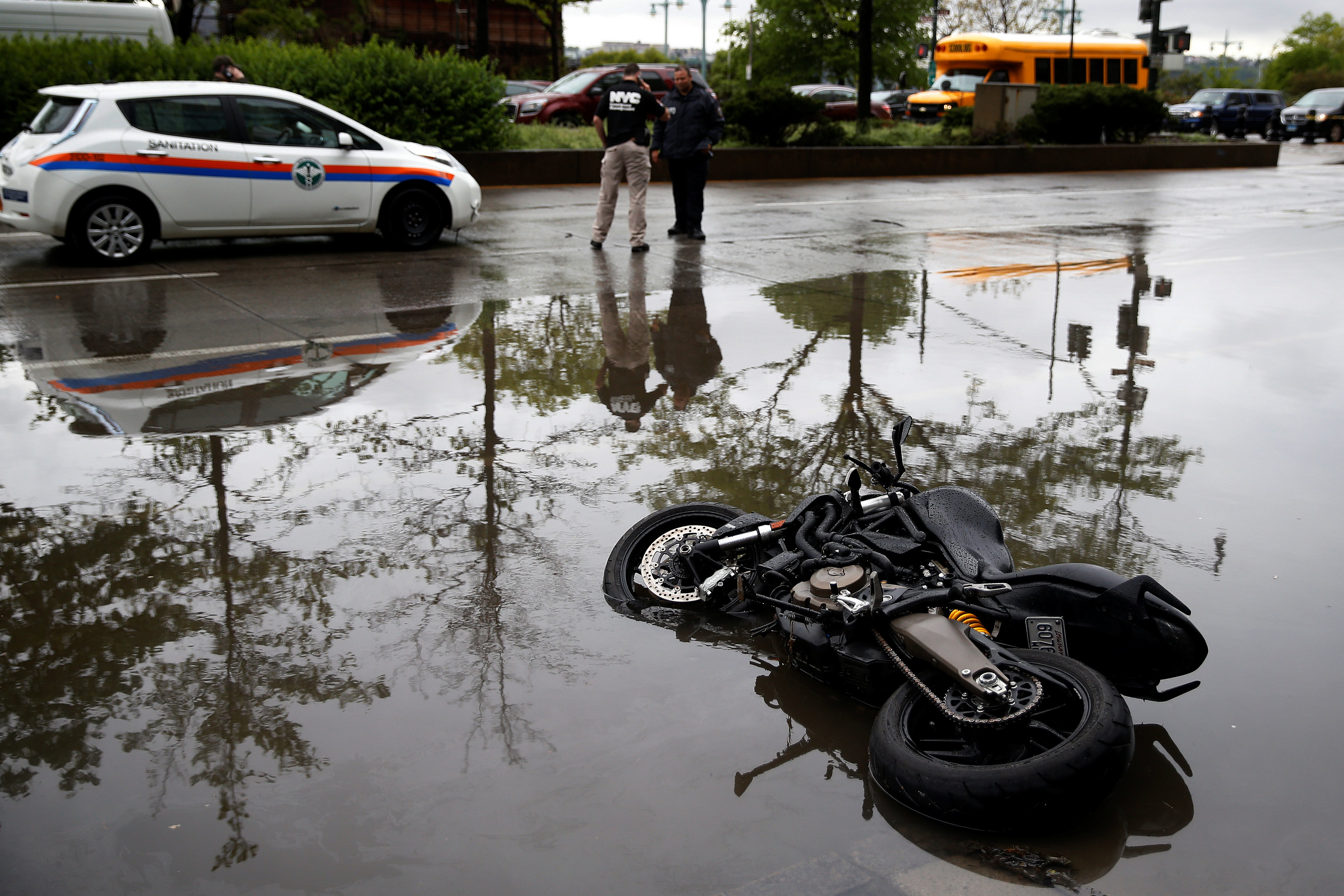 A motorcycle is seen in water on the West Side Highway after heavy rain in the Manhattan borough of New York, U.S., May 5, 2017.REUTERS/Carlo Allegri
