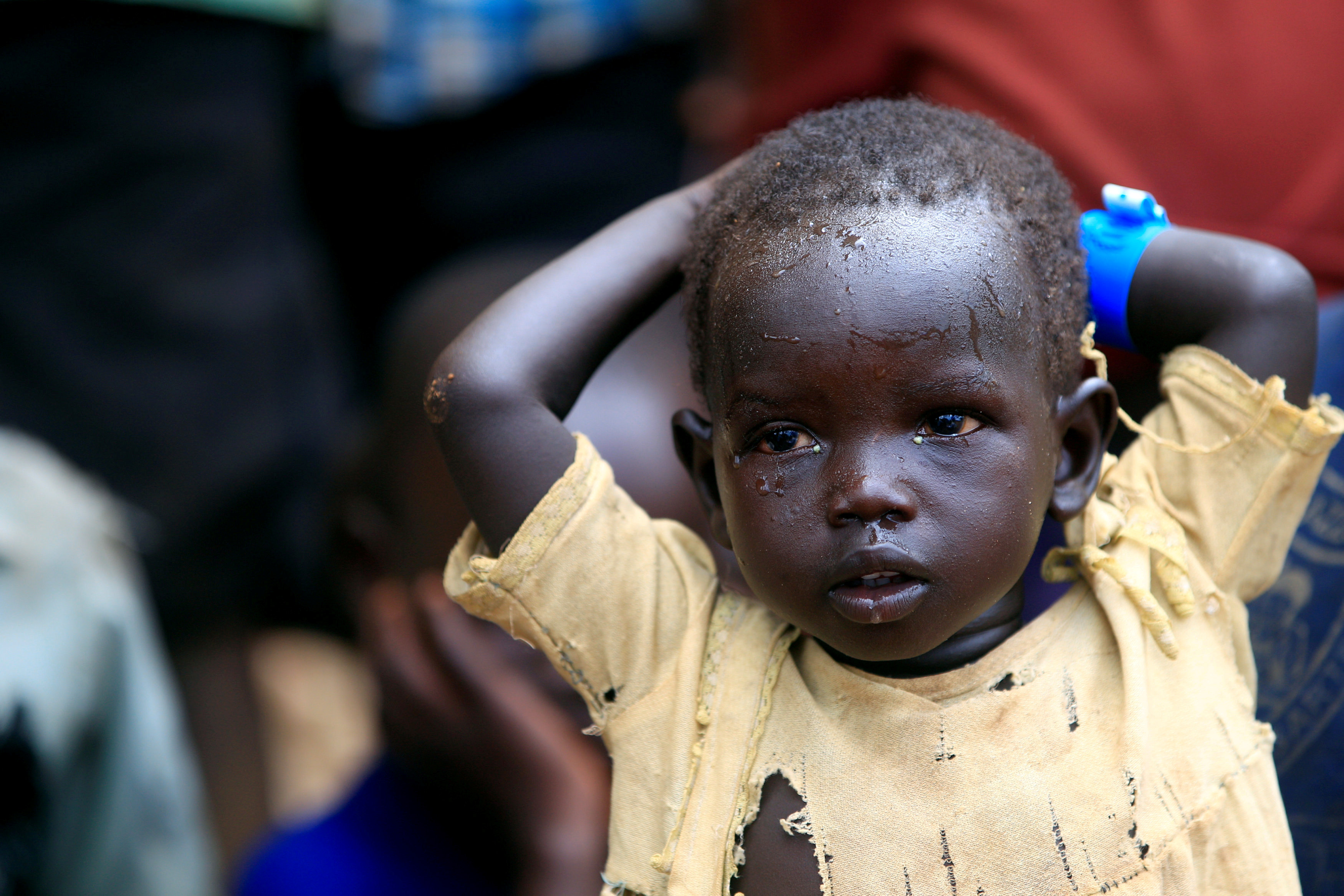FILE PHOTO: A child displaced due to fighting in South Sudan arrives in Lamwo after fleeing fighting in Pajok town across the border in northern Uganda
