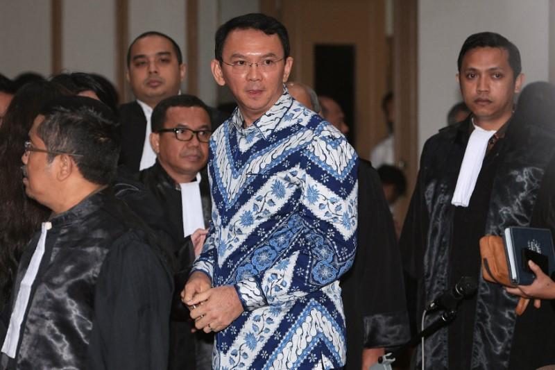 Jakarta Governor Basuki Tjahaja Purnama is seen inside a court during his trial for blasphemy in Jakarta, Indonesia May 9, 2017 in this photo taken by Antara Foto. Antara Foto/ Sigid Kurniawan/via REUTERS