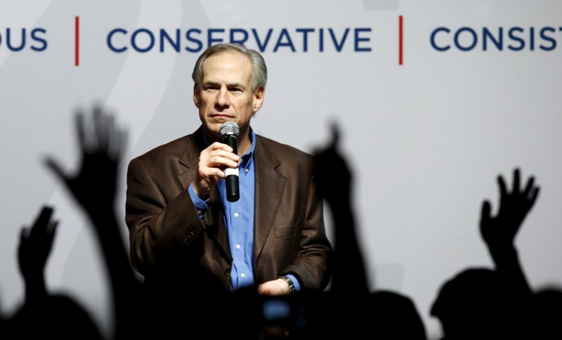 FILE PHOTO: Texas Governor Greg Abbott speaks at a campaign rally for U.S. Republican presidential candidate Ted Cruz in Dallas, Texas February 29, 2016. REUTERS/Mike Stone/File Photo