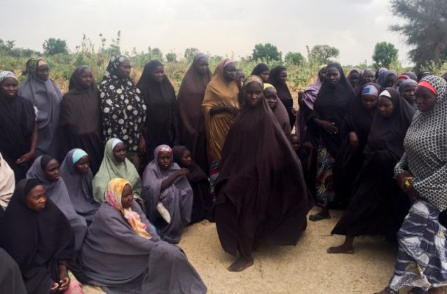 A group of 82 Chibok girls, who were held captive for three years by Islamist militants, wait to be released in exchange for several militant commanders, near Kumshe, Nigeria May 6, 2017. REUTERS/Zanah Mustapha