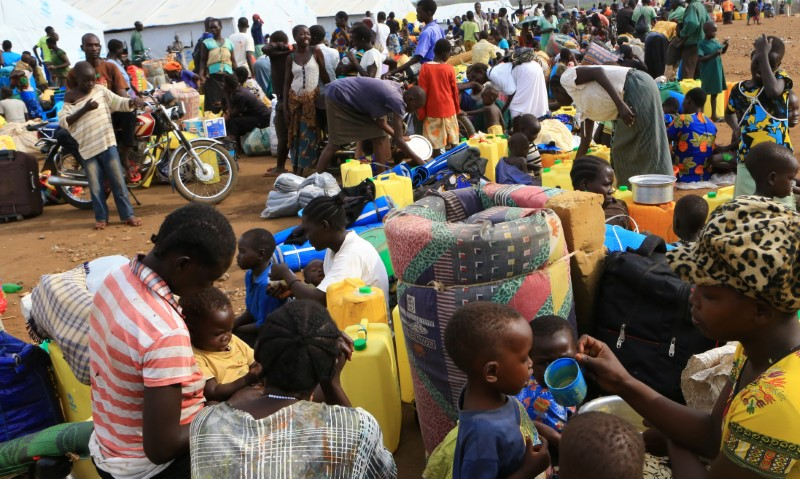 South Sudanese refugee families displaced by fighting gather at Imvepi settlement in Arua district, northern Uganda, April 4, 2017. REUTERS/James Akena