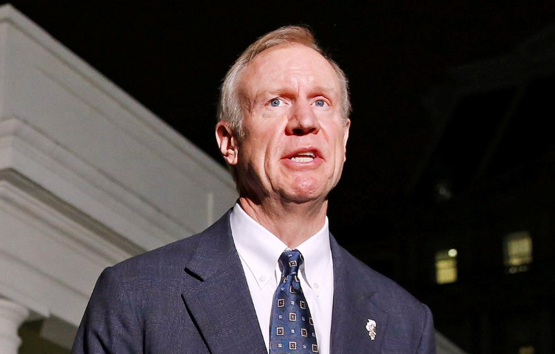 FILE PHOTO: Illinois Gov-elect Bruce Rauner speaks to the media after a meeting with U.S. President Barack Obama and other Governor-elects from seven U.S. states at the White House in Washington December 5, 2014. REUTERS/Larry Downing/File Photo