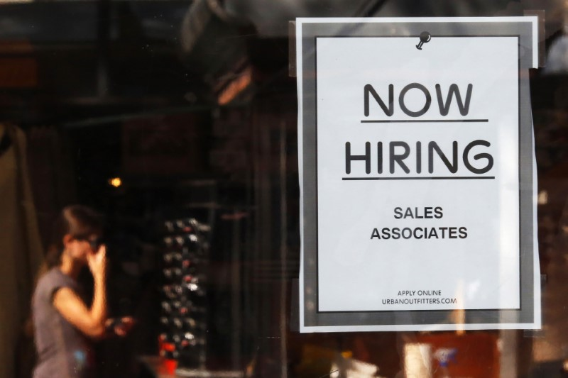 "FILE PHOTO: A ""Now Hiring"" sign hangs on the door to the Urban Outfitters store at Quincy Market in Boston, Massachusetts September 5, 2014. REUTERS/Brian Snyder"