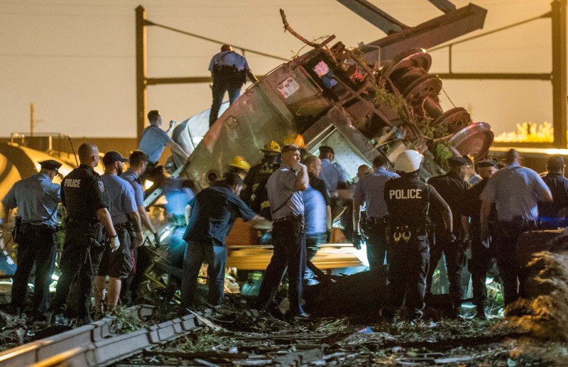 Emergency responders search for passengers following an Amtrak train derailment in the Frankfort section of Philadelphia, Pennsylvania, in this file photo dated May 12, 2015. REUTERS/Bryan Woolston