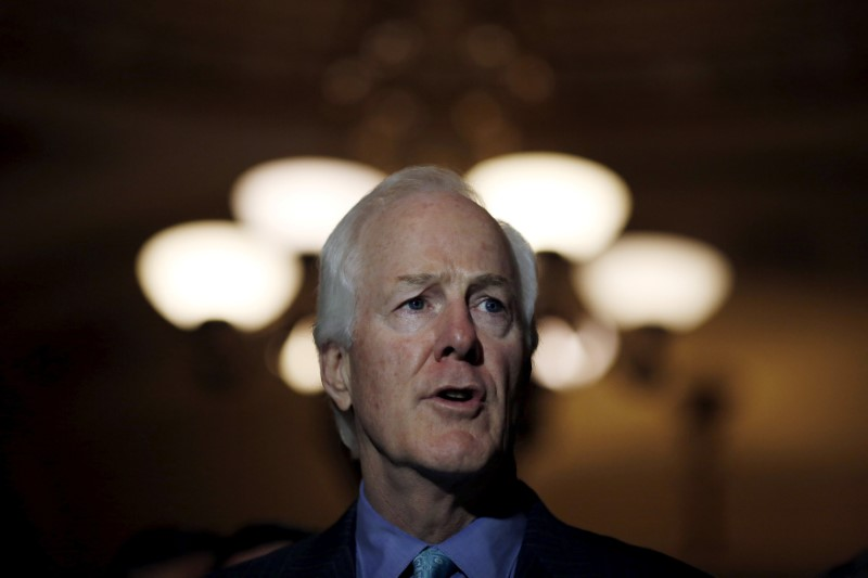 FILE PHOTO: Senator John Cornyn (R-TX) speaks during a news conference following party policy lunch meeting at the U.S. Capitol in Washington, U.S. on August 4, 2015. REUTERS/Carlos Barria/File Photo