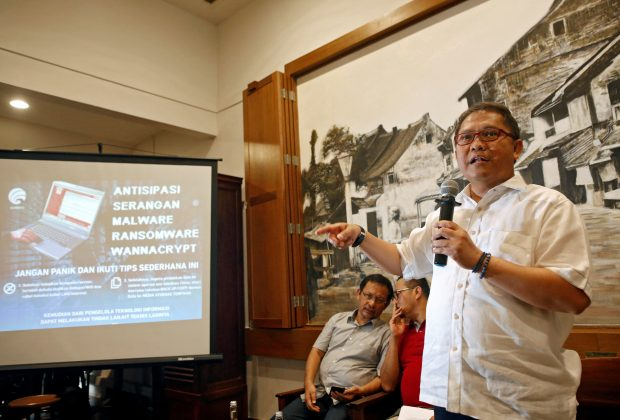 Indonesia's Minister of Communications and Information, Rudiantara, speaks to journalists during a press conference about the recent cyber attack, at a cafe in Jakarta, Indonesia