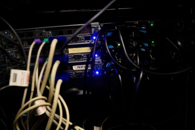 Cables and computers are seen inside a data centre at an office in the heart of the financial district in London, Britain May 15, 2017. REUTERS/Dylan Martinez