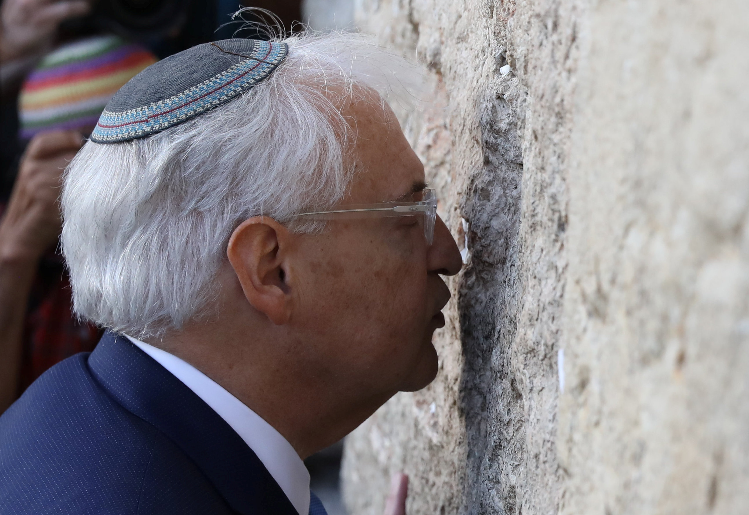 David Friedman, new United States Ambassador to Israel, kisses the Western Wall after arriving in the Jewish state on Monday and immediately paying a visit to the main Jewish holy site, in Jerusalem's Old City May 15, 2017 REUTERS/Ammar Awad