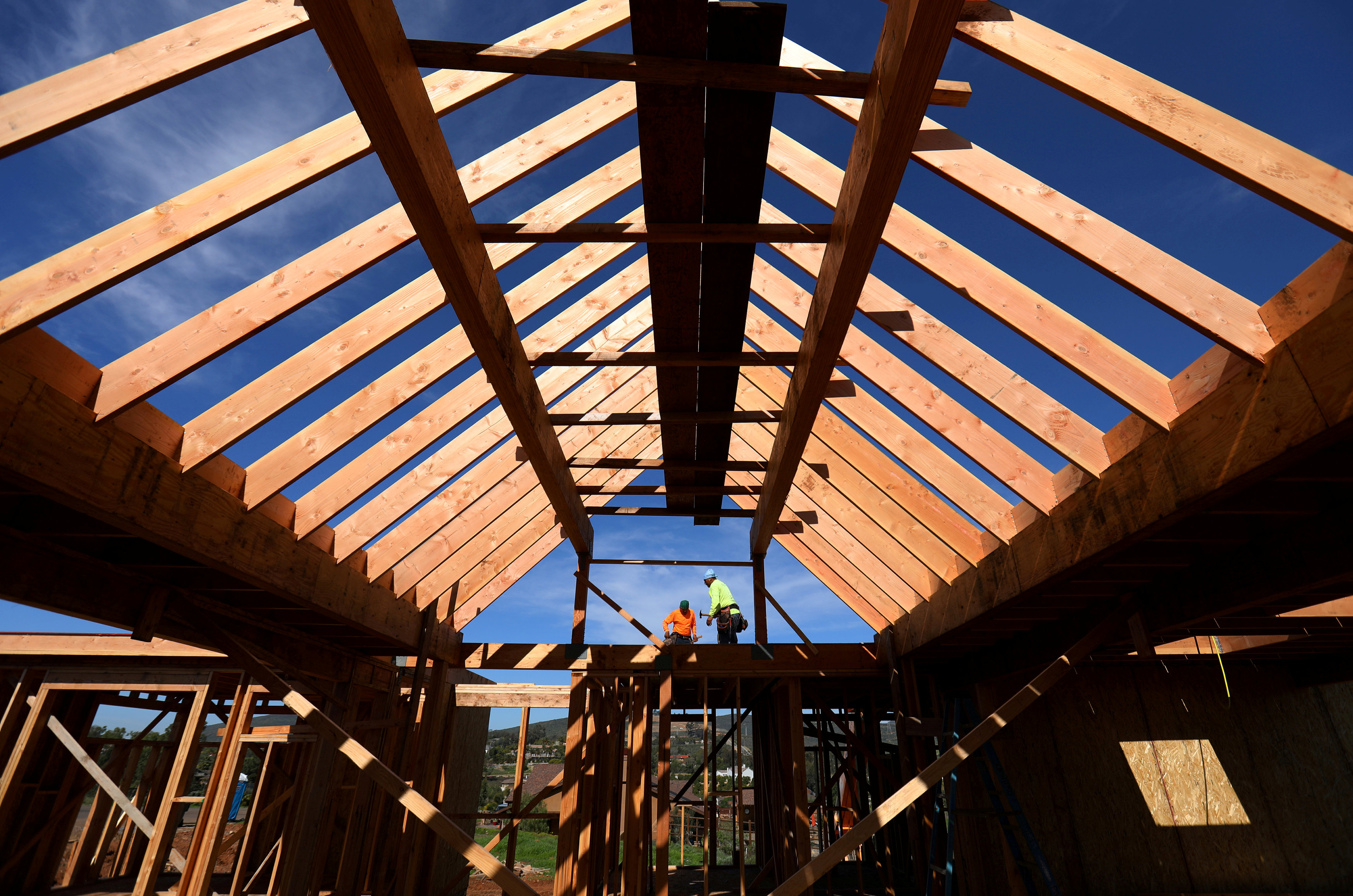 FILE PHOTO -- Construction workers build a single family home in San Diego, California, U.S. on February 15, 2017. REUTERS/Mike Blake/File Photo