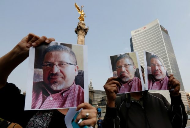 Journalists and photographers hold up pictures of journalist Javier Valdez during a demonstration against his killing and for other journalists who were killed in Mexico, at the Angel of Independence monument in Mexico City, Mexico May 16, 2017. REUTERS/Henry Romero